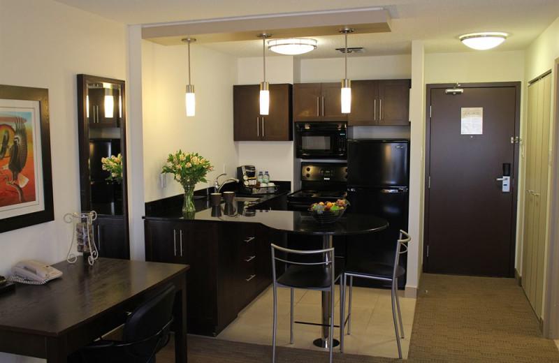 Guest kitchen at Place Louis Riel Suite Hotel.