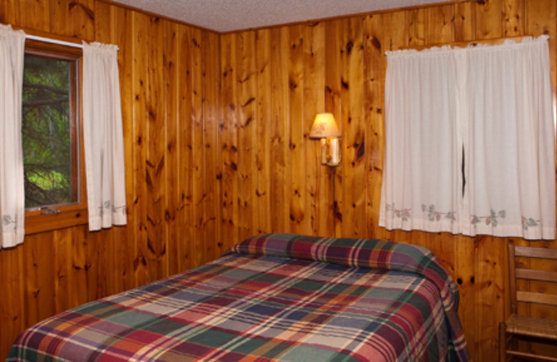 Cabin bedroom at Two Inlets Resort.