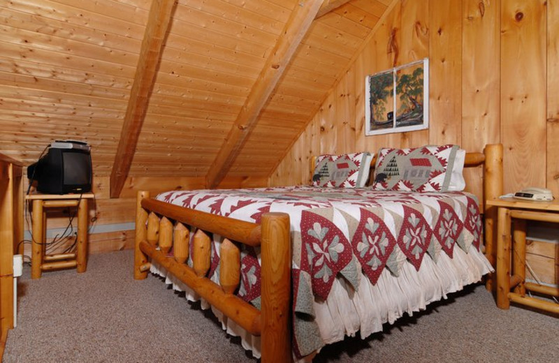Cabin bedroom at Fireside Chalets & Cabin Rentals.