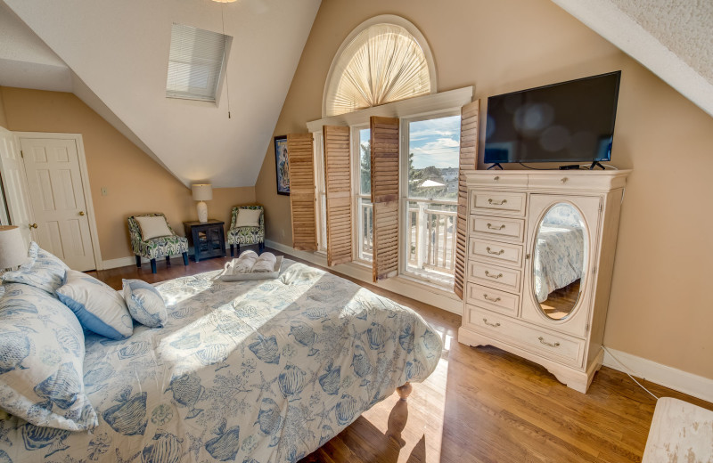 Rental bedroom at Sandbridge Blue Vacation Rentals.