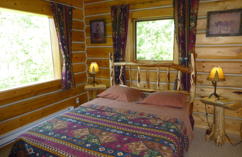 Cabin bedroom at Mica Mountain Lodge & Log Cabins.