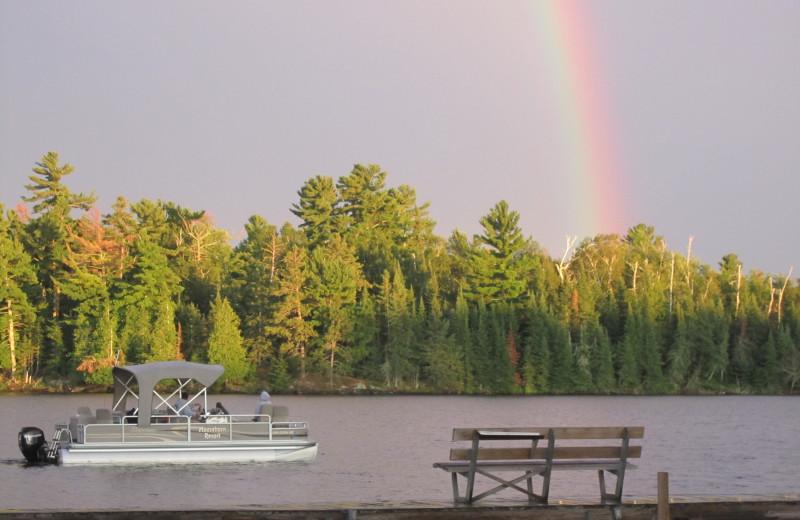 Rainbow over lake at Moosehorn Resort.