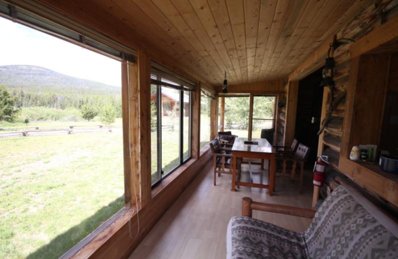 Cabin porch at Chaunigan Lake Lodge.