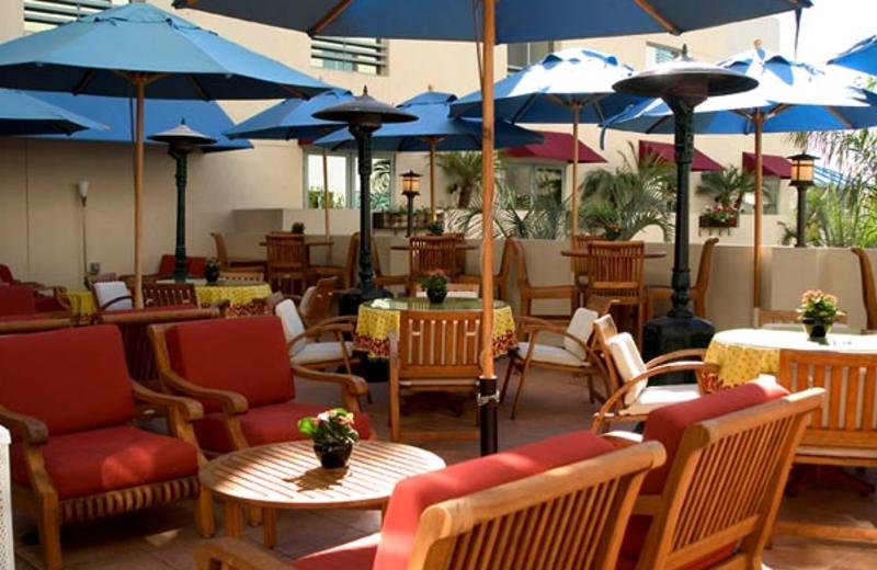 Patio view at Le Merigot Beach Hotel & Spa.