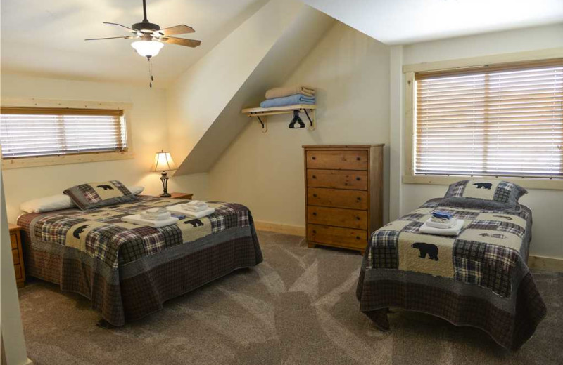 Cabin bedroom at Three Rivers Resort & Outfitting.