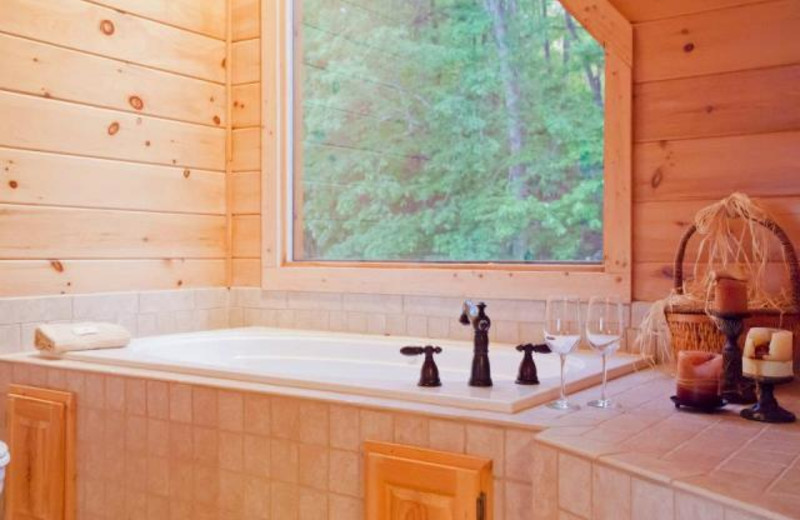 Cabin hot tub at Mountain Getaway Cabin Rentals.