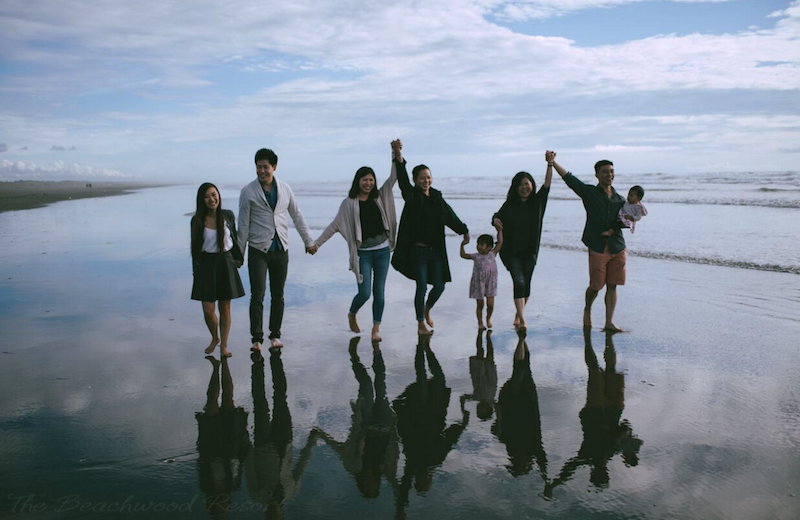 Family on beach at Beachwood Condos & Resort.