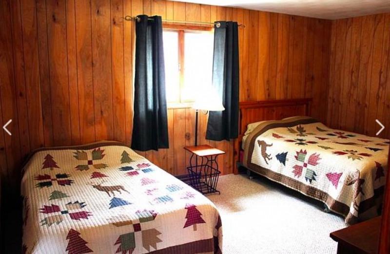 Cabin bedroom at Nitschke's Northern Resort.
