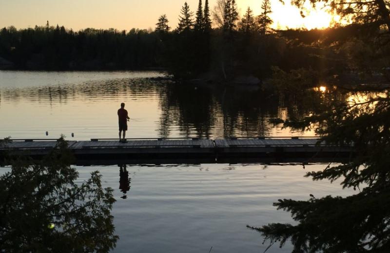 Fishing off dock at Rainbow Point Lodge.
