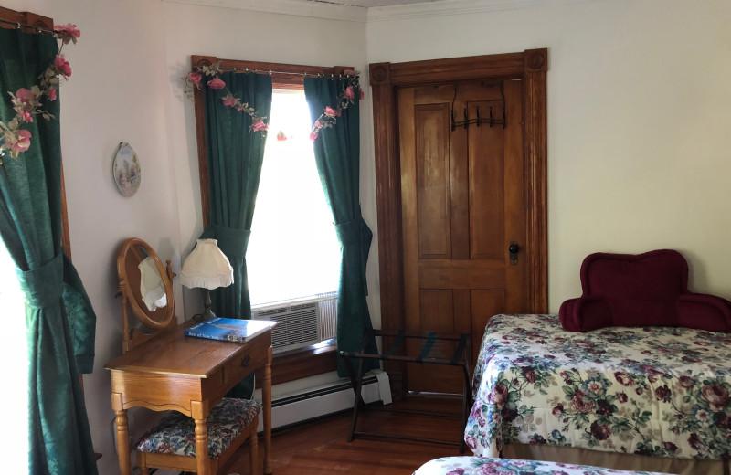 Guest room at Antique Rose Inn.
