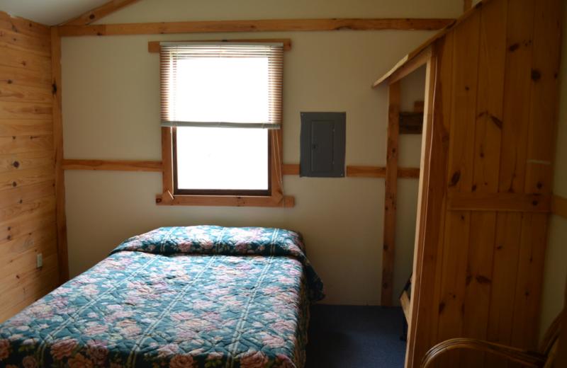 Cottage bedroom at Twin Pines Resort.