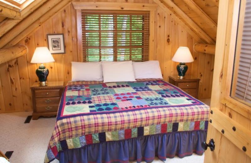 Vacation rental bedroom at Bay Breeze Resort.
