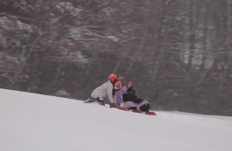 Sledding at Mountain Springs Lake Resort.