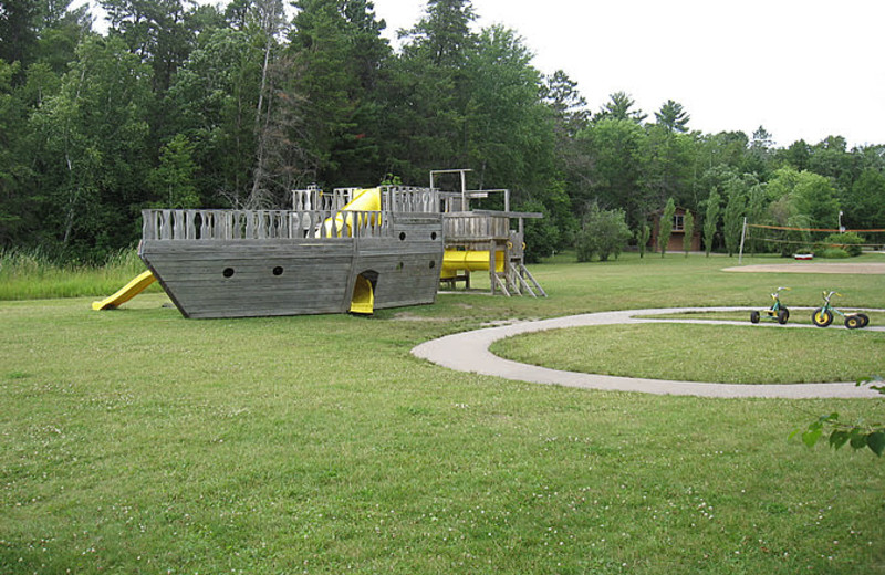 Little Norway features a large playground setting for family's to enjoy.  Swings, slides, ships, basketball, volleyball are some of what you can enjoy at Little Norway Resort.