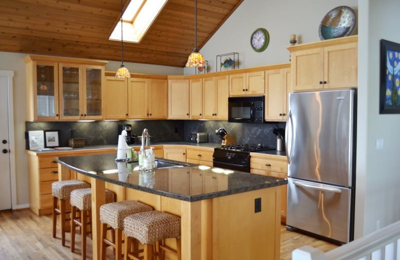 Vacation rental kitchen at Bella Beach Property Management.