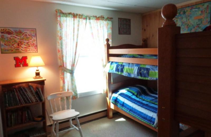 Lodge bedroom at HighWinds Lodge & Cottages.