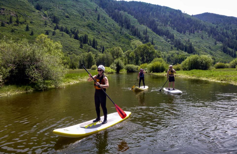 Paddle boarding at Great Smokys Cabin Rentals.