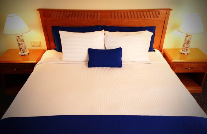 Guest bed at The White Sands Oceanfront Resort & Spa.