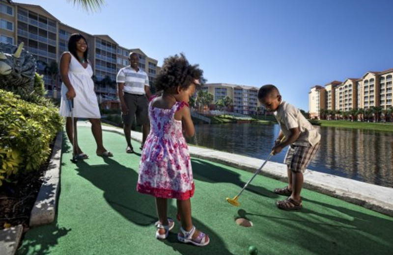 Family playing mini golf at Westgate Town Center.