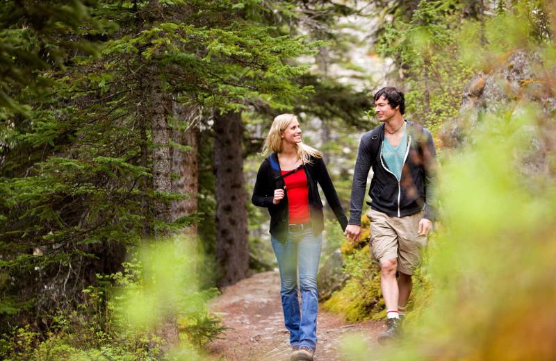 Couple taking at hike at Stony Brook Cabins LLC.