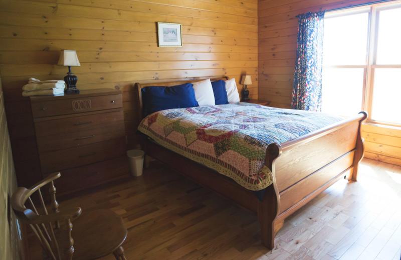 Cabin bedroom at Cobtree Vacation Rental Homes.
