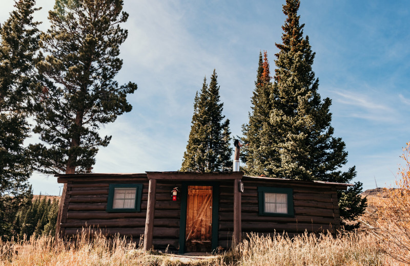 Cabin 10 exterior at Trappers Lake Lodge & Resort. This historical cabin houses for full size beds in one large room