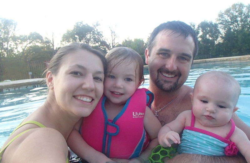 Family swimming at Mill Creek Ranch Resort.