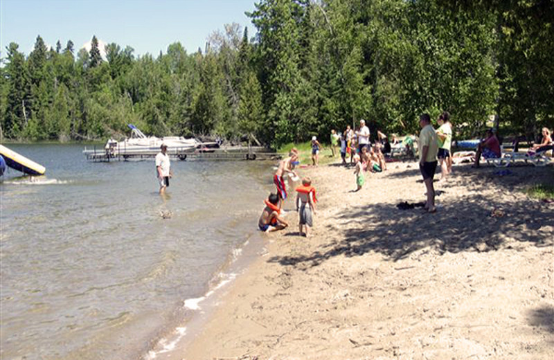 Kids playing on the beach at North Star Lake