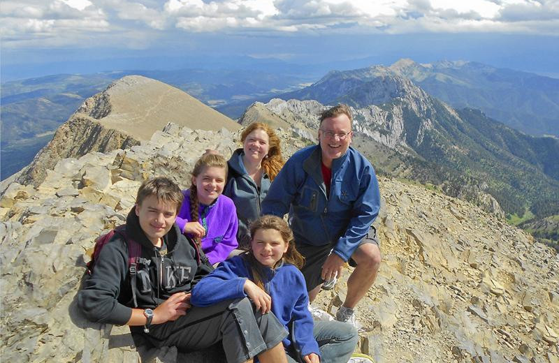Family in mountains at Bridger Vista Lodge.