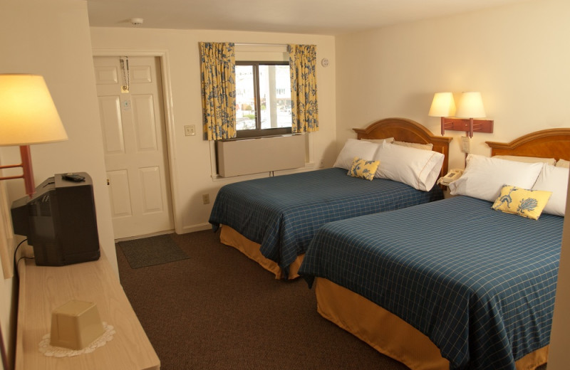Two double size beds at Sands by the Sea.