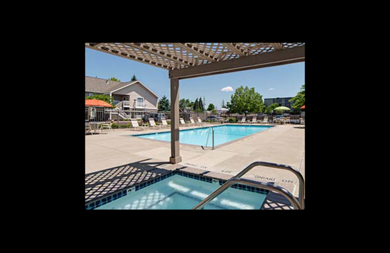 Outdoor pool at Hawthorn Suites By Wyndham Dearborn.