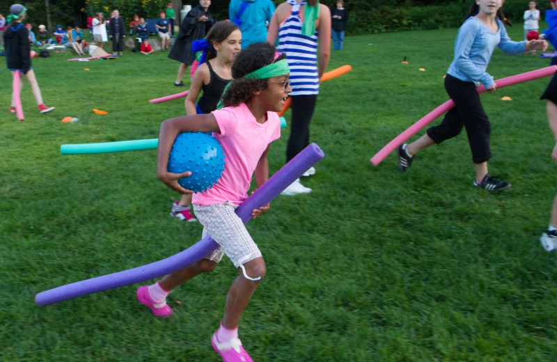 Quidditch is a favorite activity for kids and adults alike at Common Ground Center's family camp programs.