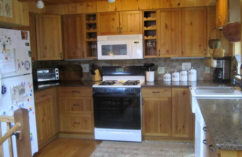 Rental kitchen at Re/Max on Island Vacation Rentals.