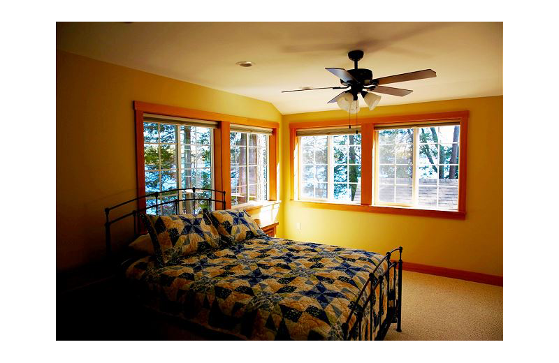 Rental bedroom At the Lakes Vacation Rentals.