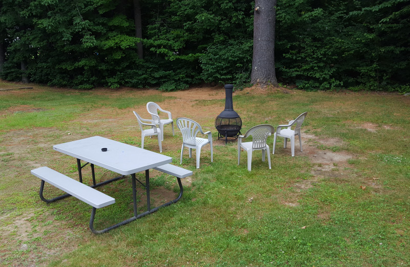 Patio at Riverbank Motel & Cabins.