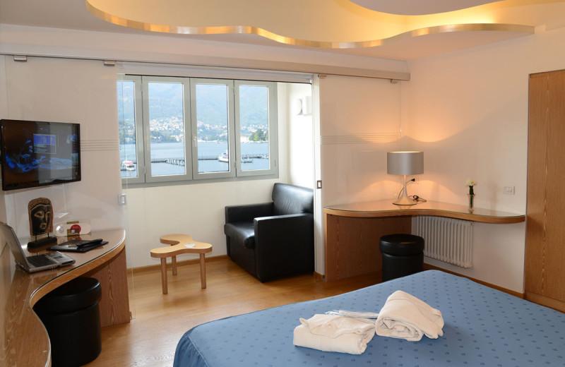 Guest room at Hotel Metropole & Suisse au Lac.
