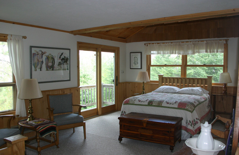 Cabin bedroom at Custom Cabin Rentals.