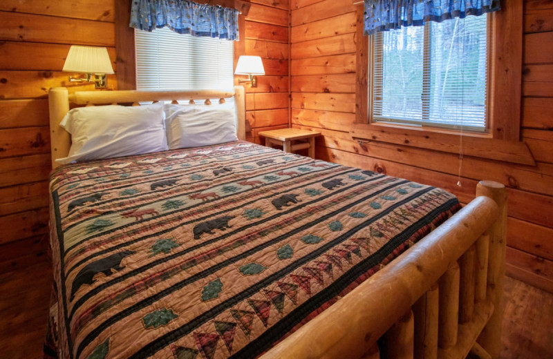Cabin bedroom at Yogi Bear's Jellystone Park Warrens.