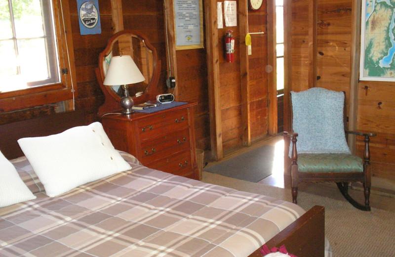 Cabin bedroom at Lake Leelanau Narrows Resort.
