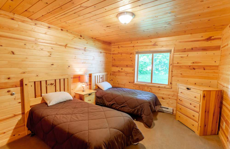 Cabin bedroom at The Red Door Resort.