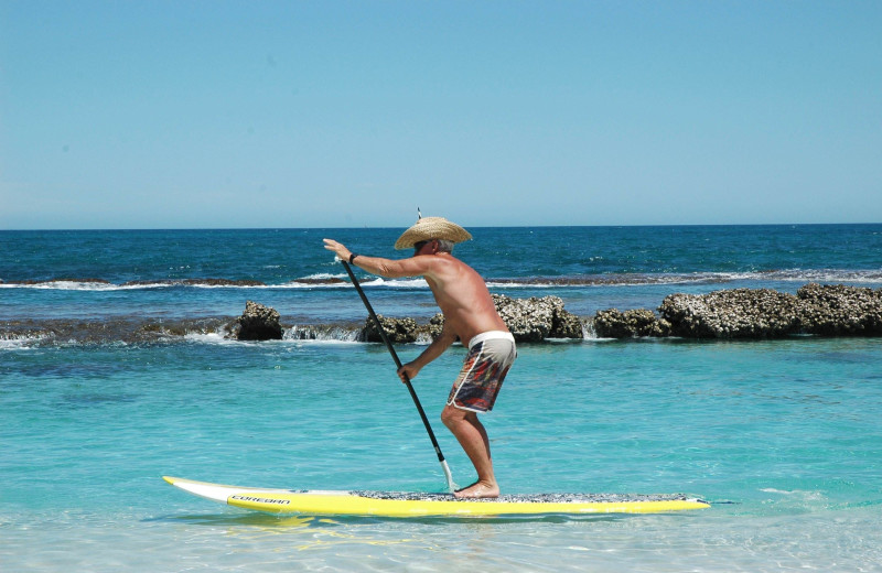 Paddle boarding at Tropical Shores Beach Resort.