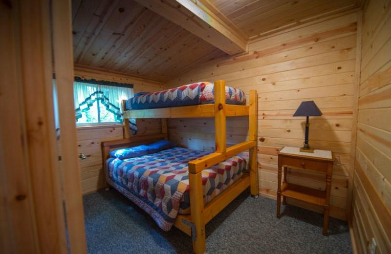 Cabin bedroom at Snyder's Idlewild Resort.
