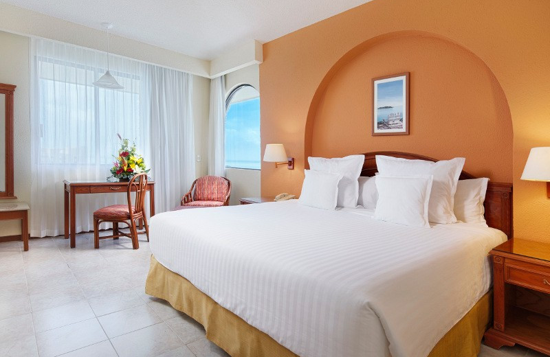 Guest room at Tucancun Beach Resort and Villas.