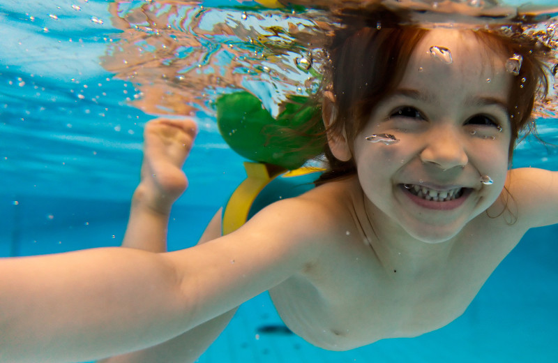 Kid swimming at Maui Sands Resort & Indoor Waterpark.