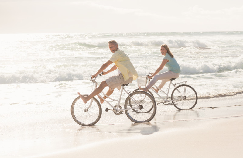 Biking on beach at Exclusive Properties - Isle of Palms.