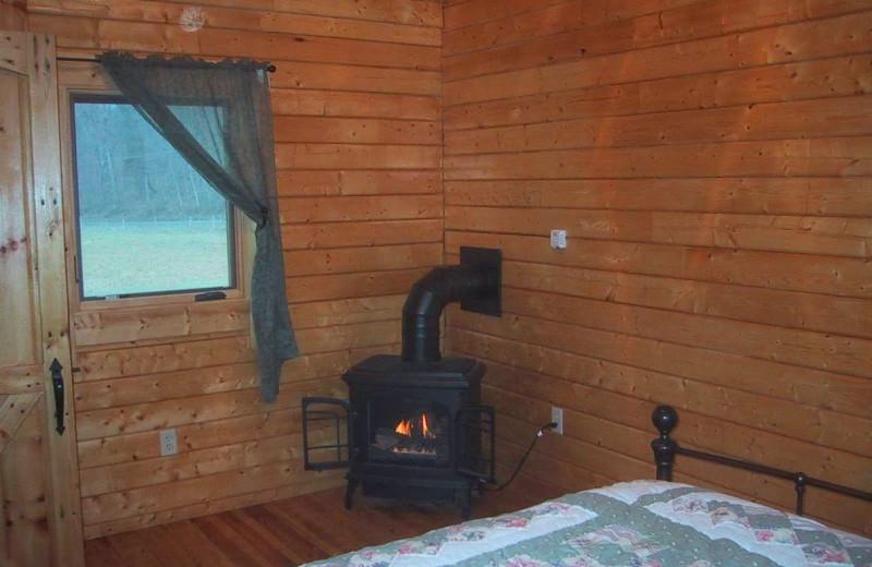 Cabin bedroom at Gander Island River Log Cabins.