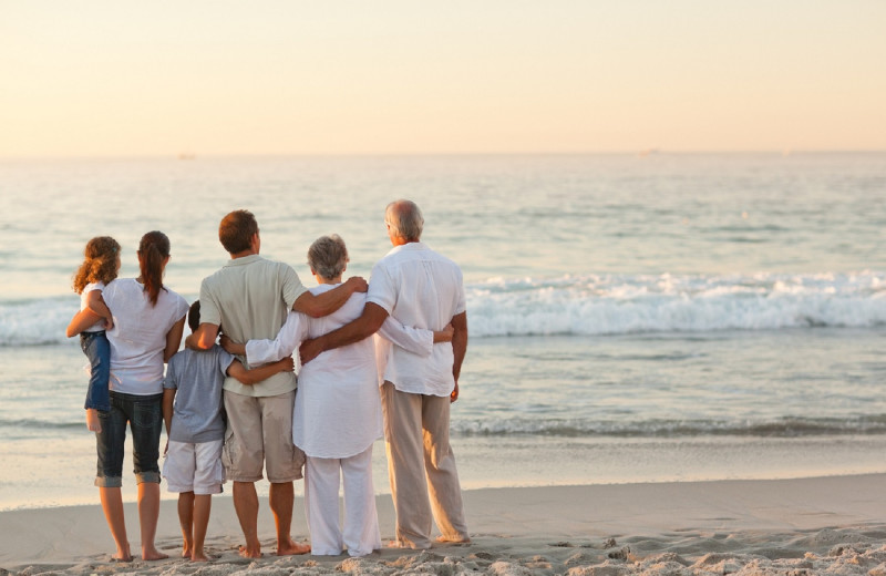 Family on beach at CBVacations.com
