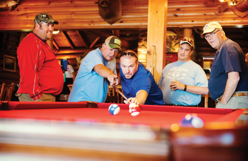 Group playing billiards at Tetu Island Lodge.