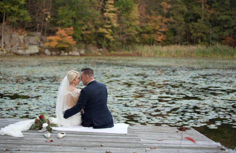 Wedding couple by lake at Arrow Park Lake and Lodge.