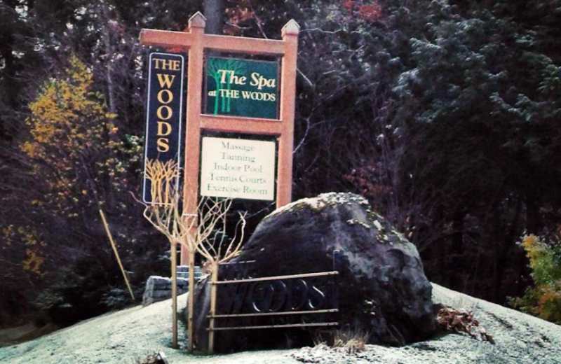The Woods Resort & Spa sign.